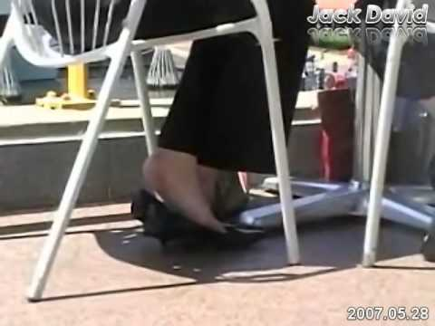 Candid shoeplay high heels at restaurant
