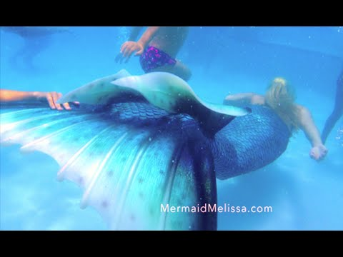Live Mermaid in resort pool for kids entertainment