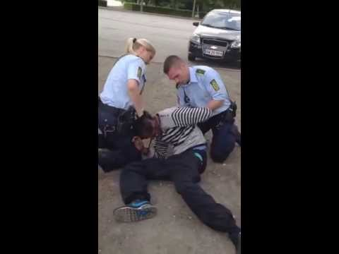 female and male police officers arresting a black guy in Denmark