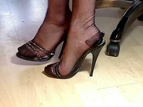 My feet and legs in black RHT nylons and 6,5″  highheeled italian sandals