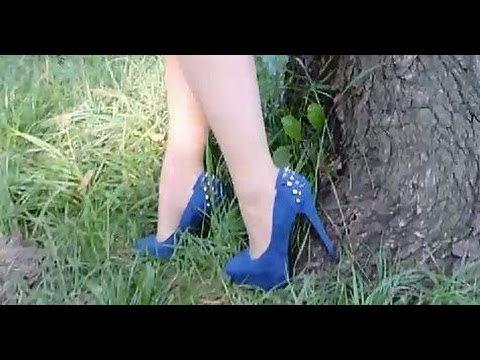 Smoking walking in extreme blue jewelry platform high heels in the grass