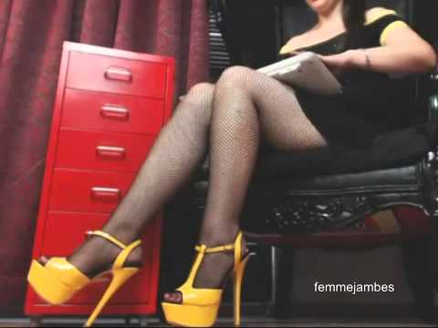Yellow high heels and legs in fishnets pantyhose shoes