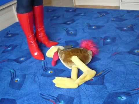 Jana destroyed with her red high heel patent leather boots a fabric chicken