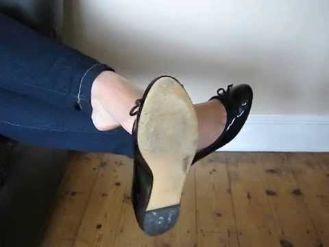 Dangling my  well used black patent ballet flats