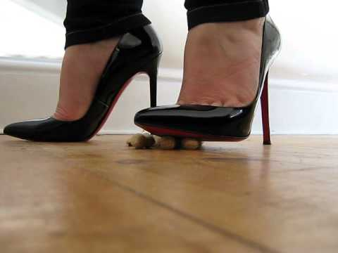 Crushing nuts with my Louboutin Pigalle heels
