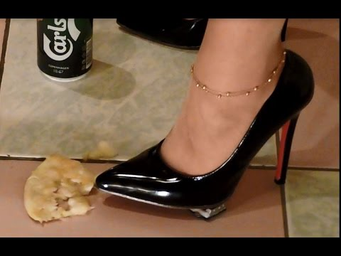 Sexy girl smoking, crushing in black 5 inch stiletto high heels with pantyhose