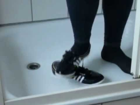 Jana trample on her Adidas Concord Round Ballerinas shiny black in the shower