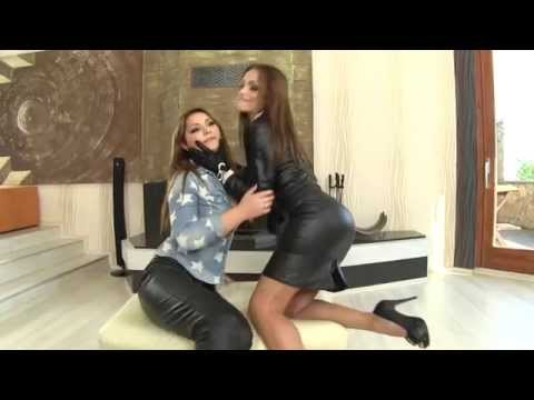 Photoshooting of two sexy girls in leather