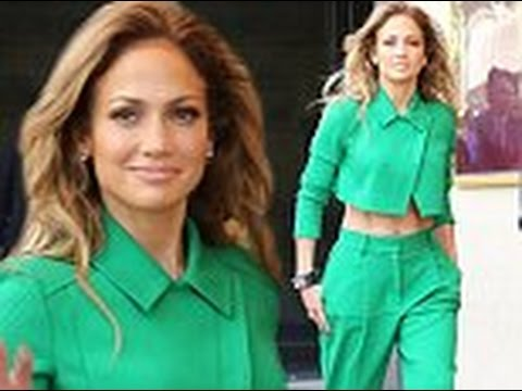 Jennifer Lopez shows off her tiny toned tummy in bright emerald crop top and matching trousers