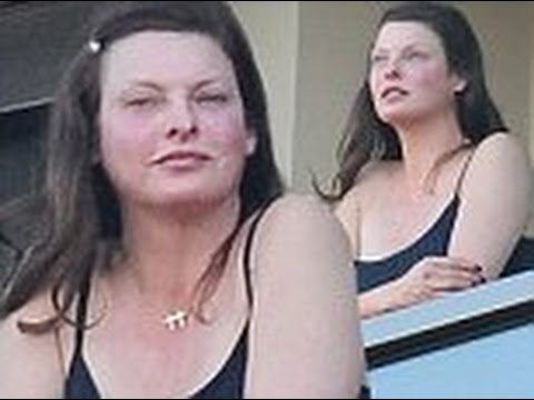 Linda Evangelista, 49, goes make-up free as she takes in the view from the balcony of her hotel