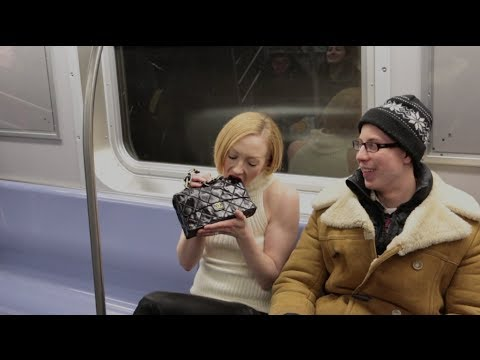 Model Eats Designer Bag on NYC Subway