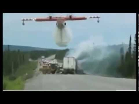 Canadian CL-415 Water bomber puts out traffic accident