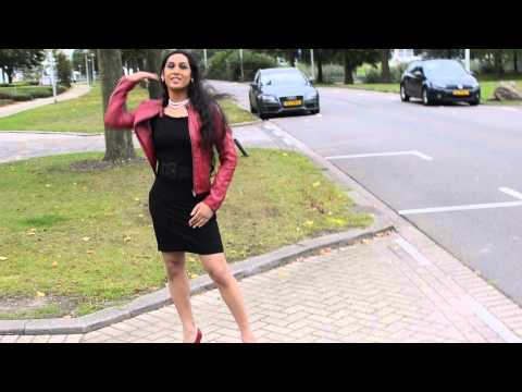 Crossdresser in red shoes and black dress