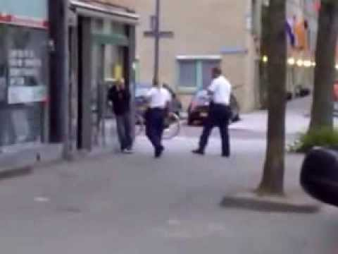 agressive blonde police woman repeatedly kicking a drunk man