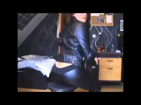 Woman smoking in Leather Clothes