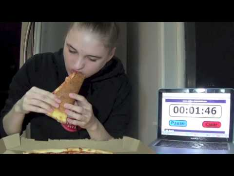 GIRL EATS 18″ PIZZA IN 7 MINUTES!!