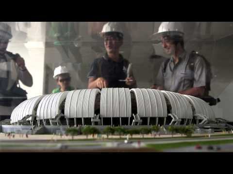 Mid Shot, visitors looking at a miniature model of Arena …